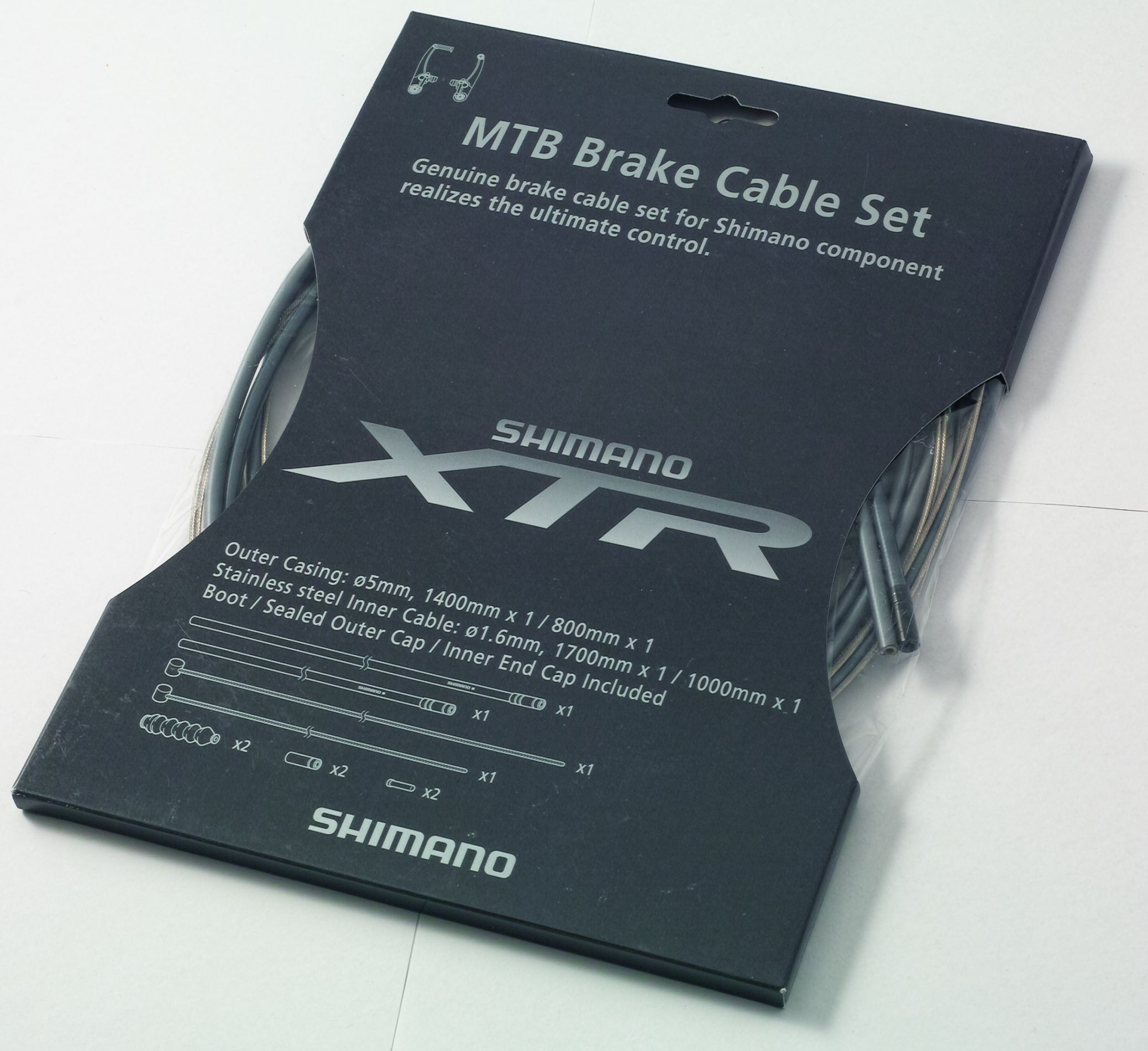 Jeu de câbles Shimano XTR pour freins de VTT, couleur grise.